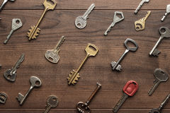 Many different keys on wooden table Stock Photo