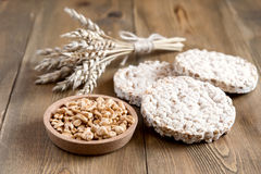 Many different kinds of products made from wheat diet crisp breads lying on wooden background Healthy organic food Rustic Stock Photo