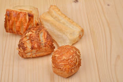 Many different kinds puff pastry with cottage cheese on wooden b Stock Photo
