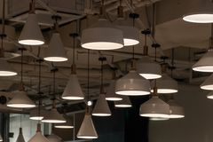 Many different lamps are hanging from above. royalty free stock photos