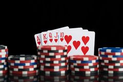 Many different levels of poker chips on the background of a winning combination of cards stock photo