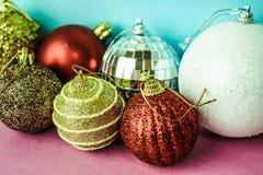 Many different multicolored shiny Christmas decorative beautiful xmas festive Christmas balls, Christmas tree toys background royalty free stock image
