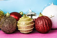 Many different multicolored shiny Christmas decorative beautiful xmas festive Christmas balls, Christmas tree toys background royalty free stock photography
