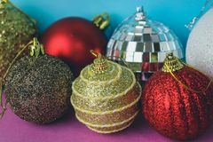 Many different multicolored shiny Christmas decorative beautiful xmas festive Christmas balls, Christmas tree toys background royalty free stock images