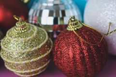 Many different multicolored shiny Christmas decorative beautiful xmas festive Christmas balls, Christmas tree toys background royalty free stock photography