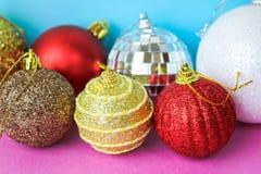 Many different multicolored shiny Christmas decorative beautiful xmas festive Christmas balls, Christmas tree toys background stock photos