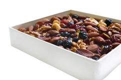 Many different nuts almonds, cashews, walnuts, dried berries blueberries, cranberries isolated Stock Photos