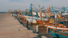 Many different old wooden fishing boats at the pier. Thailand. Asia. Pattaya stock video