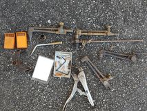 Old worn used tools on ground. Many different old worn used welding tools on asphalt ground ground stock photography