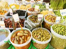 Many different olives, dried fruits on the market. Close-up royalty free stock photography