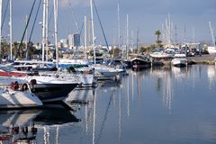 Many different sea yachts stay in marina in calm sea water royalty free stock photography