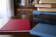 Many different sized colored and shaped books Stock Photos