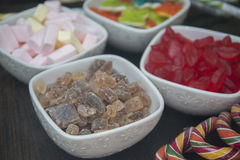 Many different sweets are in white bowls. Royalty Free Stock Photo