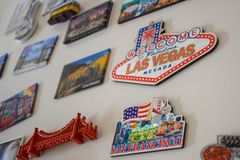 Many Different Travel Magnet Souvenirs on White Fridge, Door stock photography