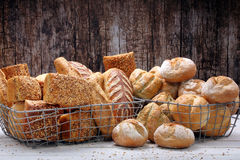 Many different types of bread in metal baskets Stock Images