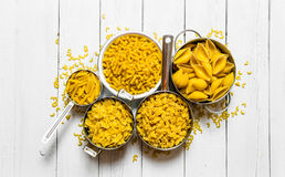 Many different types of dry pasta in the pot . Royalty Free Stock Photos