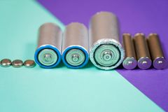 Many different types used or new battery, rechargeable accumulator, alkaline batteries on color background. Ecology recycling concept. Many different types used royalty free stock photos