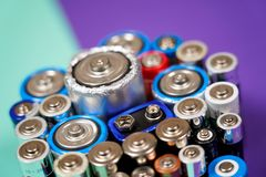 Many different types used or new battery, rechargeable accumulator, alkaline batteries on color background. Ecology recycling concept. Many different types used royalty free stock photo