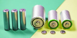 Many different types used or new battery, rechargeable accumulator, alkaline batteries on color background