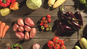 Many different vegetables lie on the table. Top view. Close up. The smooth glide of the camera  from left to right  along the old village table with a variety stock video footage