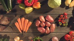 Many different vegetables lie on the table. Top view. Close up. The smooth glide of the camera  from right to left  along the old village table with a variety stock video footage