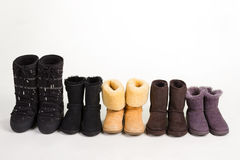 Many different winter boots on a white background. Stock Image