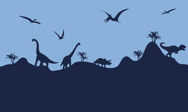 Many dinosaur in hills scenry silhouette Royalty Free Stock Images