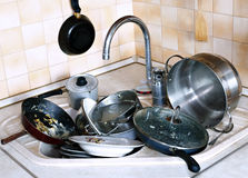 Many of dirty dishes in the sink in kitchen Royalty Free Stock Images