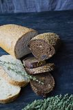 Many diverse bread on a wooden board stock photography