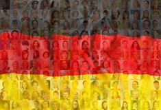 Many diverse faces on Germany national flag royalty free stock photos