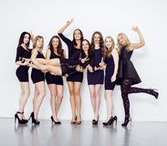 Many diverse women in line, wearing fancy little black dresses, party makeup, vice squad concept Stock Photo