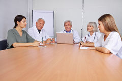 Many doctors in a team meeting stock photo