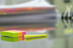 Many documents are placed on the desk.Used post-it as Alert tool. Many documents are placed on the desk. Documents need to be verified, corrected using skill royalty free stock image