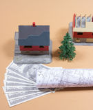 Many dollar banknotes and a house model. Concept of buying a house. Royalty Free Stock Image