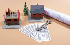 Many dollar banknotes, key and a house model. Concept of buying a house. Stock Photo