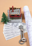 Many dollar banknotes, key and a house model. Concept of buying a house. Royalty Free Stock Photography