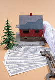 Many dollar banknotes, key and a house model. Concept of buying a house. Stock Images