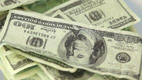 Many dollar bills spinning stock footage