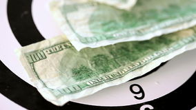Many dollar bills spinning on a target. Against a white background stock footage