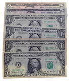 Many dollar bills on white background Stock Photos