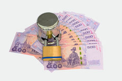 Many 500 dollar locked by safety padlock Royalty Free Stock Images