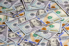 Many 100 dollars banknotes background Stock Photos