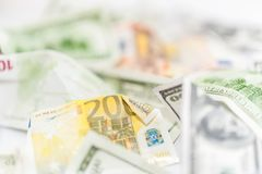 Fake dollars and euro crumpled money background. Many dollars and euro, leading currencies, close-up. Counterfeit american and european crumpled banknotes stock image