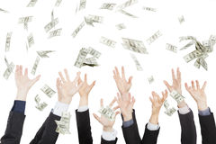 Many dollars falling on hand Stock Images