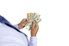Many dollars falling on man's hand with money Royalty Free Stock Photography