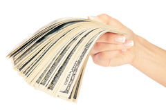 Many dollars falling on woman's hand Royalty Free Stock Images