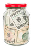 Many dollars in a glass jar Royalty Free Stock Images
