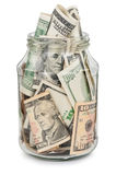 Many dollars in a glass jar Stock Photography