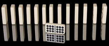Many Dominos standing in a row Stock Photos