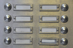 Many door bells in rows Royalty Free Stock Photos